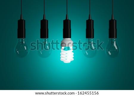 Light bulbs on cyan background - stock photo