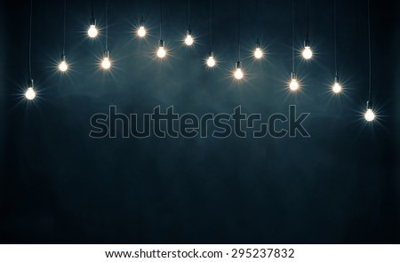 Light bulbs on dark blue background - stock photo