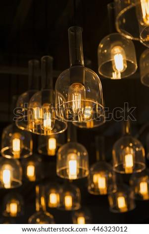 Light bulbs with base in a row - stock photo