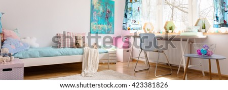 Light child room with details in pastel colors, single bed, simple chair and desk