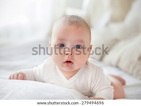Light close up portrait of adorable baby boy - stock photo