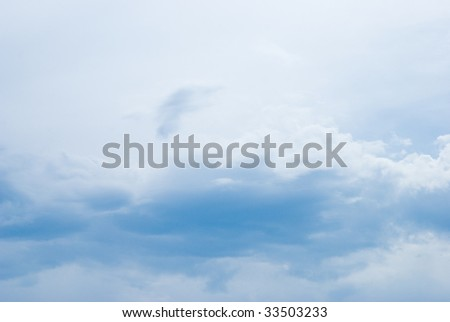 Light clouds flowing through a summer sky - stock photo