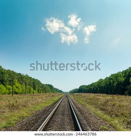 light clouds in blue sky over railroad to horizon - stock photo