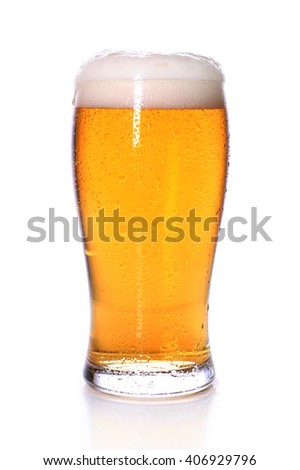 Light cold beer in a glass glass on a white background