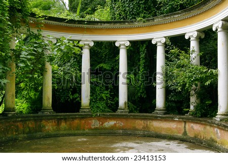 Light columns in classical style in an environment of green vegetation - stock photo