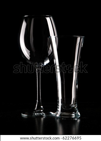 Light contour of wineglass and beerglass  in dark color - stock photo