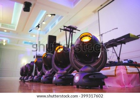 light equipment at banquet hall in pink light - stock photo