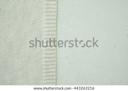 light fabric over white background. white wooden board jersey . knitted fabric texture . white paint old board . - stock photo