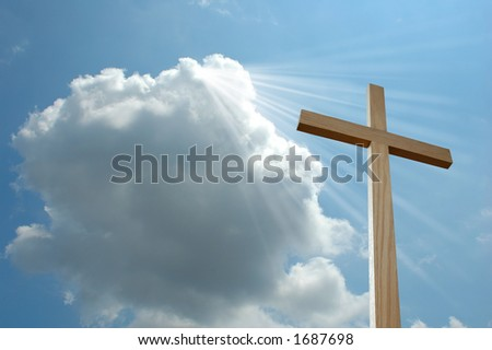 Light from a cloud shining on cross