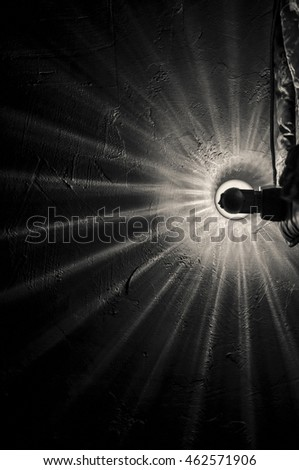 Light from a lamp in the form of a sharp beam