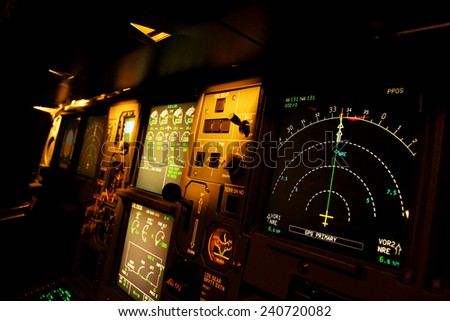 Light from a plane control  room in the dark. - stock photo
