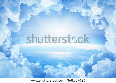 Light from heaven, blue planet Earth in white clouds, bright sunlight from above. Elements of this image furnished by NASA nasa.gov - stock photo