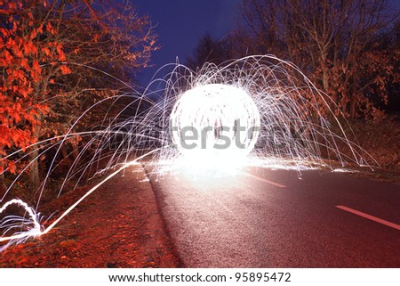 Light graffiti on a road - stock photo