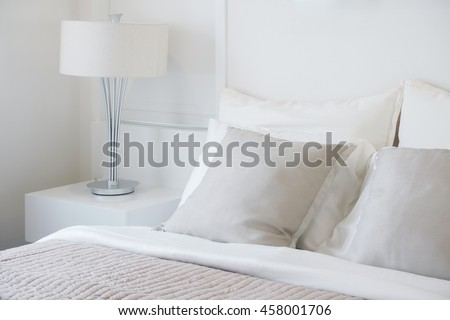 Light gray pillow setting on bed in nice vibe bedroom modern interior style - stock photo