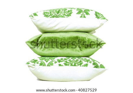 Light green and white cushions against white background - stock photo