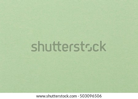 Light green paper background, colorful texture. High quality image.