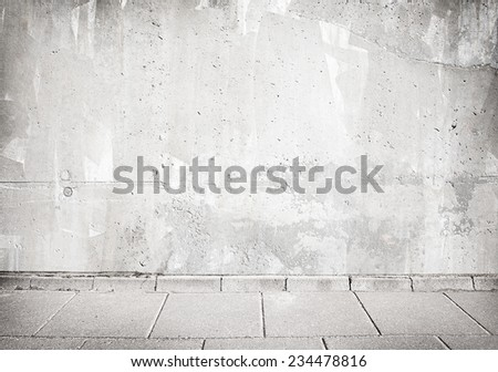 Light grey concrete wall texture with walkway. - stock photo
