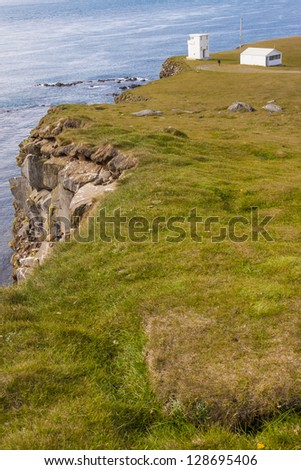 Light house and cliffs on Latrabjarg - Iceland. - stock photo
