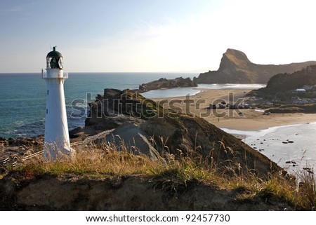 Light house on coast - dusk - stock photo