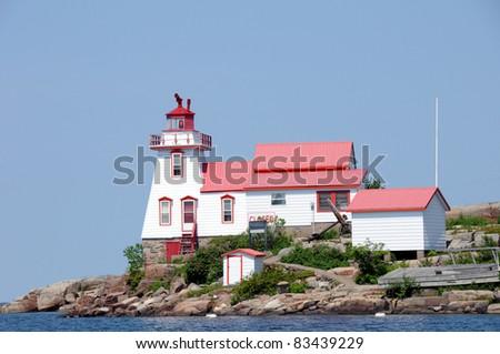 Light House on Georgian Bay at Pointe Au Baril - stock photo