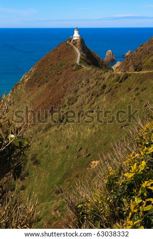 Light house on nugget point in the catlins, new zealand - stock photo
