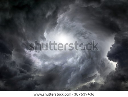 Light in the Dark and Dramatic Storm Clouds - stock photo