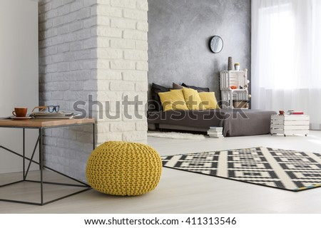 Light interior with white  decorative brick wall  yellow pouffe and  spacious bedroom. Pouffe Stock Images  Royalty Free Images   Vectors   Shutterstock
