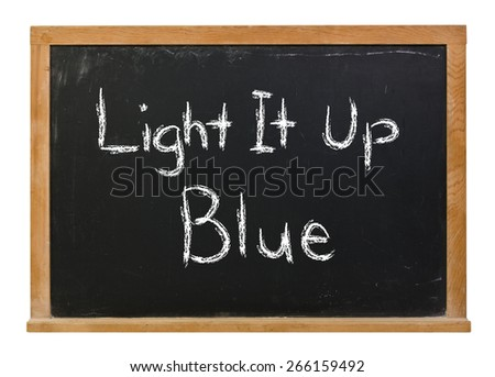 Light it up blue written in white chalk on a black chalkboard isolated on white - stock photo
