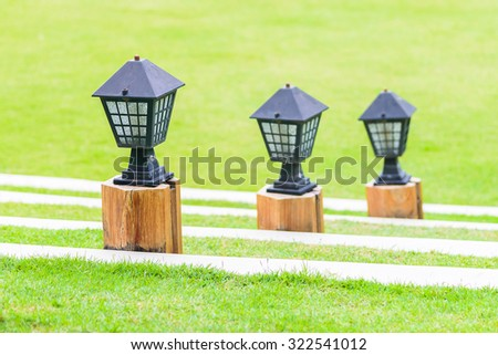 Light lamp with garden outdoor view
