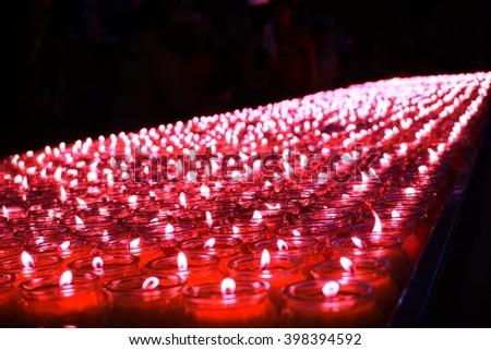 light of candle in the glass cup used for offering in Chinese New Year - stock photo