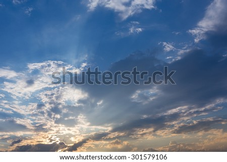 light of sunbeam on sunset sky background with clouds and sunlight - stock photo