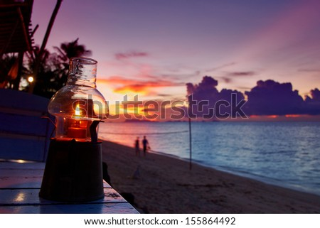 Light on the table against sunset view beach resort on Koh Samui, Thailand - stock photo