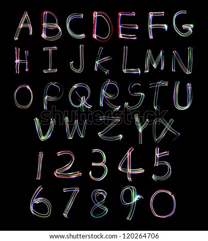 Light painting photograph of the alphabet and numbers 1 to 9