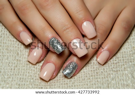 light pink or beige manicure with silver ring finger - stock photo