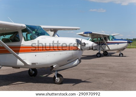 Light planes parked on the private airfield in summer