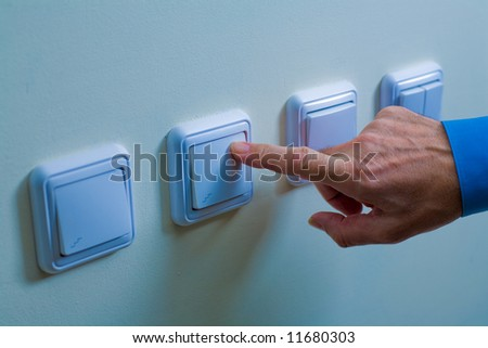 light power switch being turned on off - stock photo