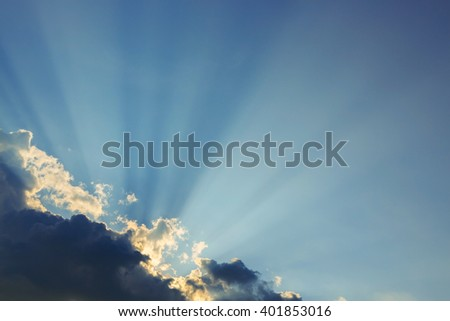 light rays explosion on clear blue sky with cloud - stock photo