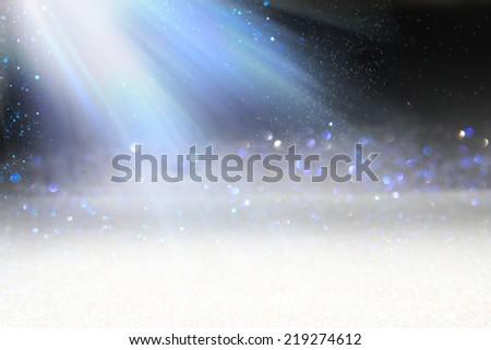 Light rays over snow sparks, defocused. - stock photo