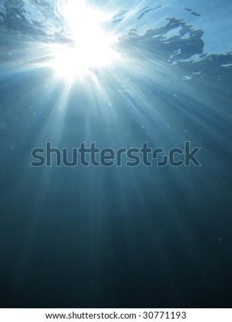 Light rays underwater - stock photo