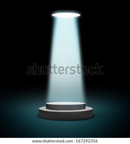 Light shines on the gray podium - stock photo