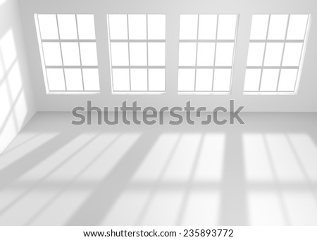 Light shining through the windows in white empty room