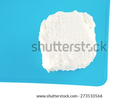 light soft cheese on plate over white - stock photo
