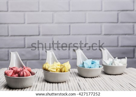 Light space with brick background and colorful sweets