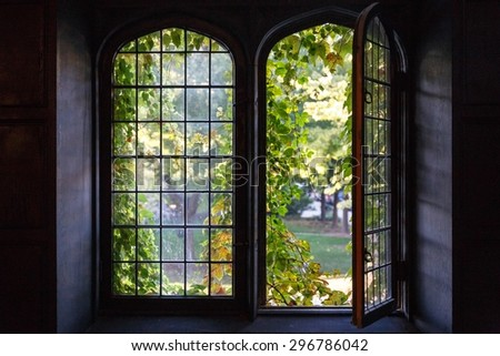 Light spills through a half-open window at a university building in Chicago, IL, USA in early Fall 2014. - stock photo