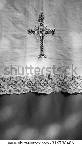 Light spots on the altar  cover. Sunlight filtered through the stained glass window in church. A game of light and shadow. Aged photo. Black and white. - stock photo