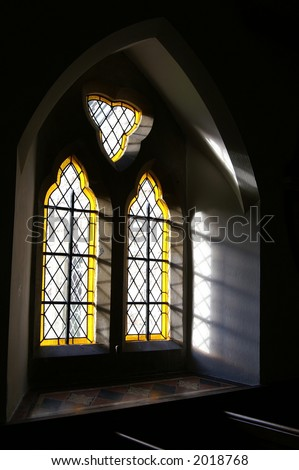 Light streaming through church window - stock photo
