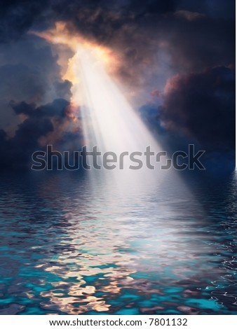 Light streams down from above onto tropical sea
