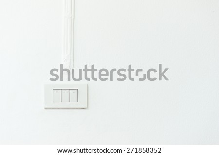 light switch on cement wall - stock photo