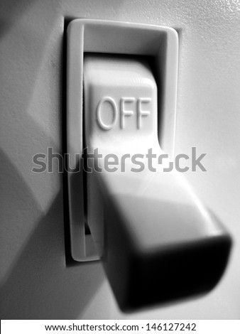 Light switch on wall inside a home in off position - stock photo