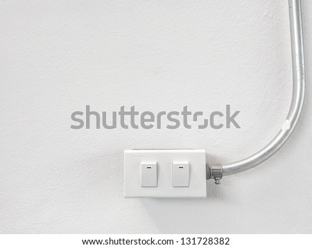 Light switch on white wall